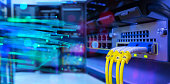 Fiber optic cable and Network switch 24 port gigabit blending with fiber optic cable and lighting of fiber optics in network center room
