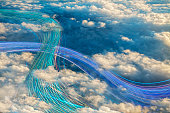 Fiber optic cables crossing in cloudy sky