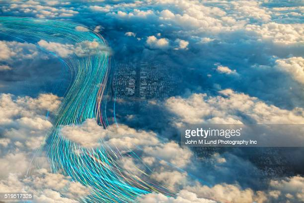 Fiber optic cables in cloudy sky over city