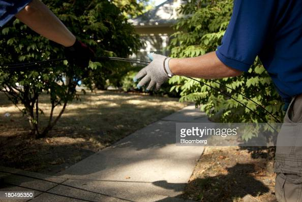 Fiber optic internet cable is pulled by hand through underground tubing during installation in Minneapolis Minnesota US on Thursday Sept 11 2013 The...