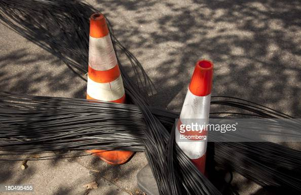 Fiber optic internet cable sits looped into an '8' formation before it will be passed through a new set of underground tubing during installation in...