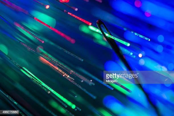 Fiber optic passing through eye of needle