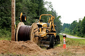 Power company installing underground electricity in Crivitz, WI, USA in August 2017. To eliminate over head wires.
