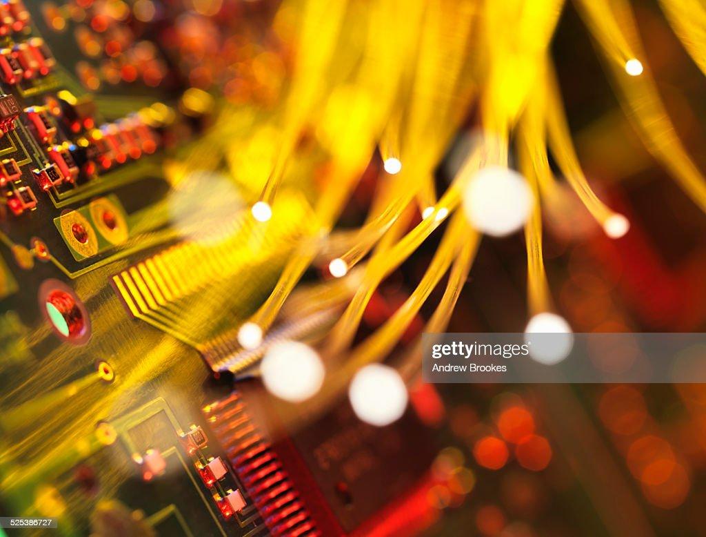 Fibre optics carrying data passing a circuit board