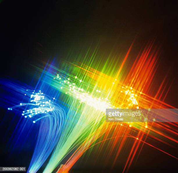 Fibre-optic strands in rainbow colours, close-up
