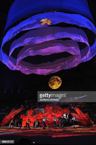 Fiddlers and dancers perform as they represent Canada's fiddling tradition and the colors of fall during the opening ceremony for the Vancouver...