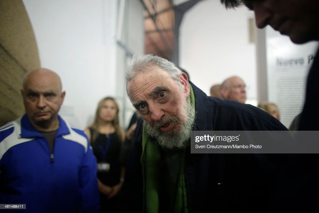 <a gi-track='captionPersonalityLinkClicked' href=/galleries/search?phrase=Fidel+Castro&family=editorial&specificpeople=67210 ng-click='$event.stopPropagation()'>Fidel Castro</a>, Cuba's former President and revolutionary leader, looks at the camera during a rare public appearance to attend the inauguration of an art gallery on January 8, 2014 in Havana, Cuba. Castro, who ceded power to his brother Raul Castro in 2008 after falling ill in 2006, has last been seen in public in February 2013 at a National Assembly meeting. The gallery Castro visited is run by Cuban artist Alexis Leyva, aka Kcho.