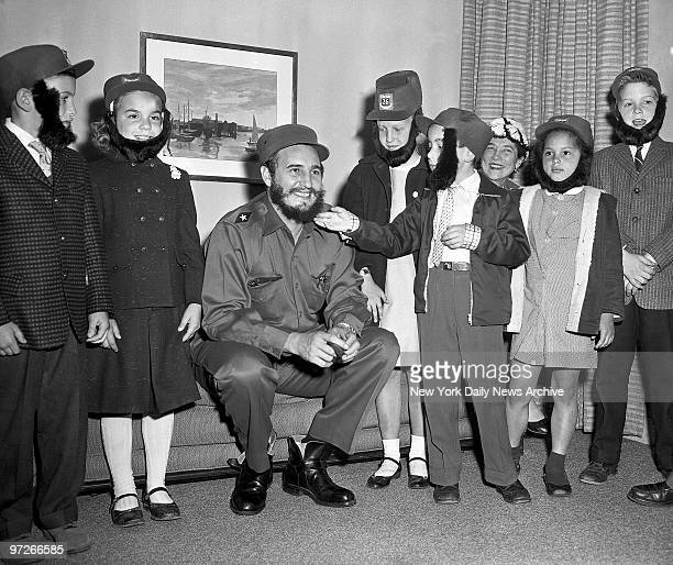 Fidel Castro has his beard admired during a visit to his hotel by youngsters who attended a Queens school with his son The boy was secretly living...