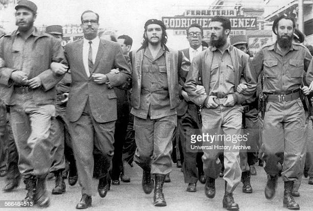 Fidel Castro Left next to Osvaldo Dortic's with Che Guevara at a parade during March 1960 in Havana