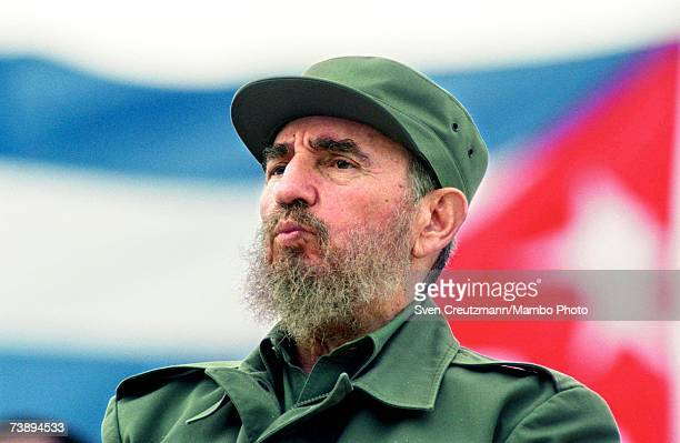 Fidel Castro observes the May Day parade at the Revolution Square in Havana Cuba May 1 1998