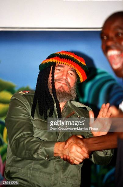 Fidel Castro shakes hands with a Cuban touroperator who is Jamaica who had made a reggae rasta cap as a present to Castro on the occasion of a...