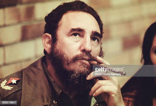 Fidel Castro smokes a cigar in his office in Havana Cuba circa 1977