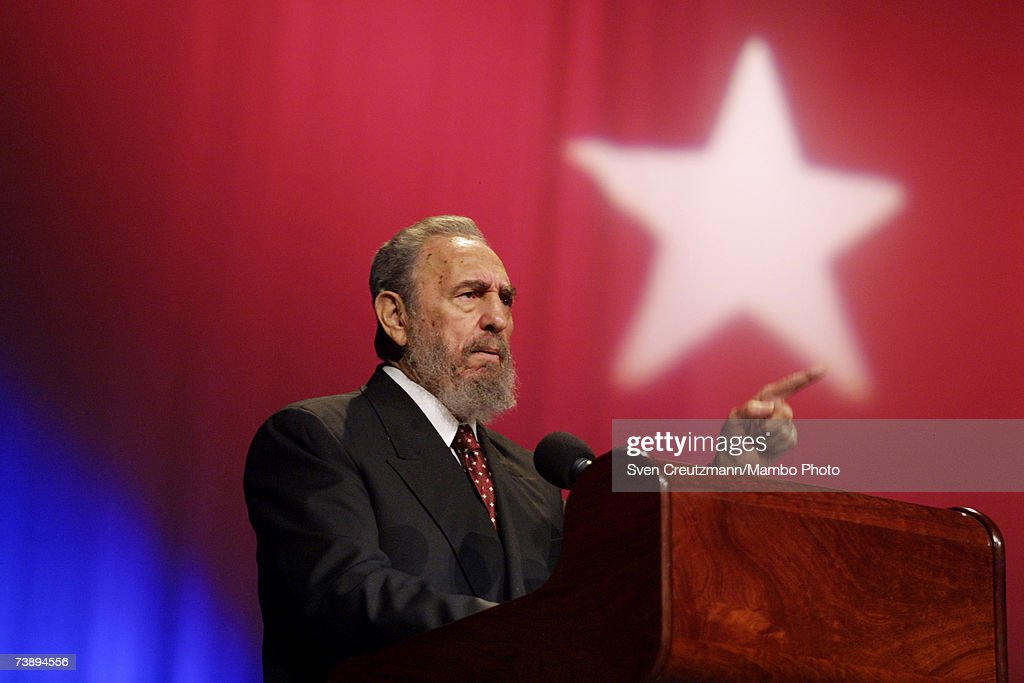 <a gi-track='captionPersonalityLinkClicked' href=/galleries/search?phrase=Fidel+Castro&family=editorial&specificpeople=67210 ng-click='$event.stopPropagation()'>Fidel Castro</a> speaks during a ceremony celebrating the inauguration of emergency classes for high school teachers in the President <a gi-track='captionPersonalityLinkClicked' href=/galleries/search?phrase=Salvador+Allende&family=editorial&specificpeople=220786 ng-click='$event.stopPropagation()'>Salvador Allende</a> school, in the Karl Marx Theatre, September 9, 2002 in Havana, Cuba. The Cuban national flag with the colous blue, red and white, carrying the white star in the center, is shown in the background.