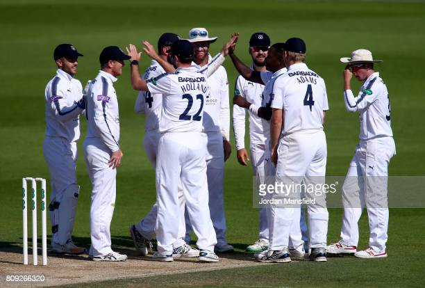 Fidel Edwards of Hampshire celebrates with his teammates after dismissing Sam Curran of Surrey during day three of the Specsavers County Championship...