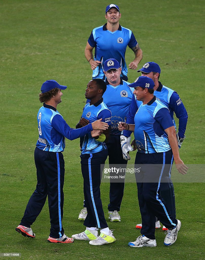 <a gi-track='captionPersonalityLinkClicked' href=/galleries/search?phrase=Fidel+Edwards&family=editorial&specificpeople=217762 ng-click='$event.stopPropagation()'>Fidel Edwards</a> of Leo Lions celebrates the wicket of Humayun Farhat of Virgo Super Kings with his team-mates during the Oxigen Masters Champions League Semi Final match between Leo Lions and Virgo Super Kings at Dubai International Cricket Stadium on February 12, 2016 in Dubai, United Arab Emirates.