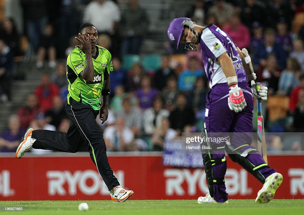 <a gi-track='captionPersonalityLinkClicked' href=/galleries/search?phrase=Fidel+Edwards&family=editorial&specificpeople=217762 ng-click='$event.stopPropagation()'>Fidel Edwards</a> of the Thunder celebrates after taking the wicket of <a gi-track='captionPersonalityLinkClicked' href=/galleries/search?phrase=Phil+Jaques&family=editorial&specificpeople=214545 ng-click='$event.stopPropagation()'>Phil Jaques</a> of the Hurricanes during the T20 Big Bash League match between the Hobart Hurricanes and the Sydney Thunder at Bellerive Oval on January 1, 2012 in Hobart, Australia.