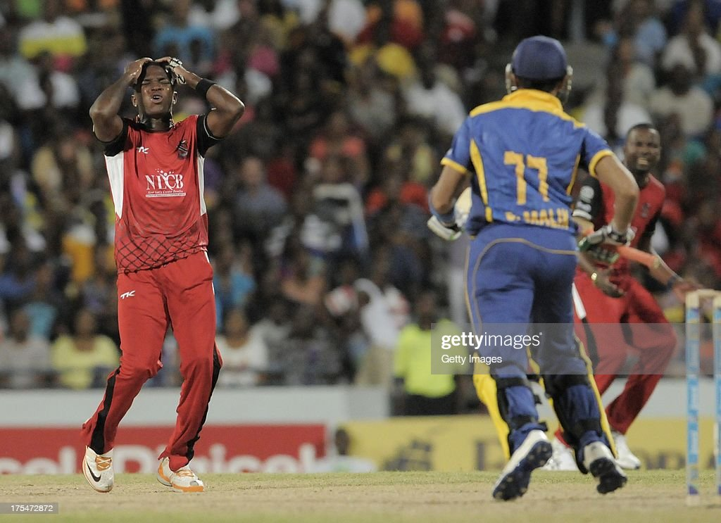 <a gi-track='captionPersonalityLinkClicked' href=/galleries/search?phrase=Fidel+Edwards&family=editorial&specificpeople=217762 ng-click='$event.stopPropagation()'>Fidel Edwards</a> of Trinidad & Tobago Red Steel reacts against <a gi-track='captionPersonalityLinkClicked' href=/galleries/search?phrase=Shoaib+Malik&family=editorial&specificpeople=221455 ng-click='$event.stopPropagation()'>Shoaib Malik</a> of Barbados Tridents during the Fifth Match of the Caribbean Premier League between Barbados Tridents v Trinidad & Tobago Red Steel at Kensington Oval on August 3, 2013 in Bridgetown, Barbados.