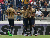 Fidel Martinez and Eduardo Herrera of Pumas celebrate a goal of their team during a 8th round match between Pumas UNAM and Veracruz as part of the...