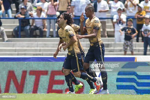 Fidel Martinez of Pumas celebrates with his teammates after scoring the second goal of his team during a 6th round match between Pumas UNAM and...