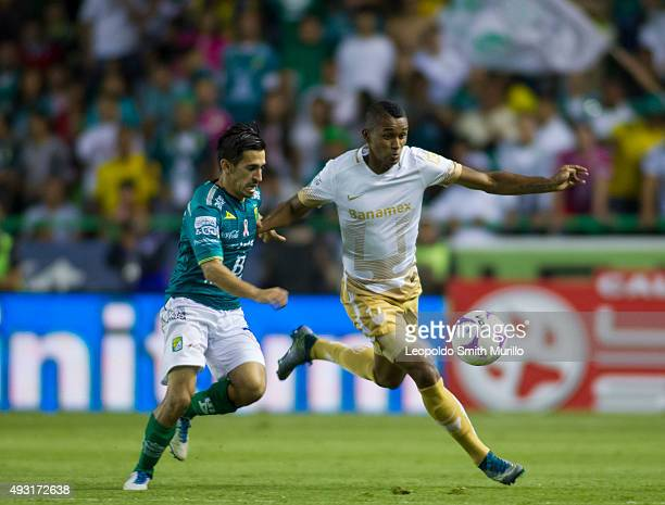 Fidel Martínez of Pumas fights for the ball with Fernando Navarro of León during the 13th round match between Leon and Pumas UNAM as part of the...