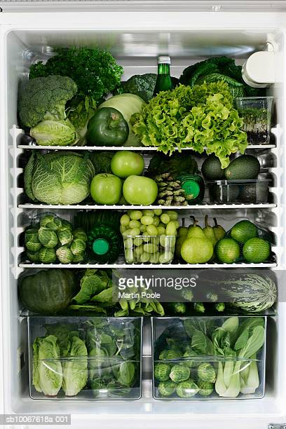 Fidge filled up with green vegetables and fruit