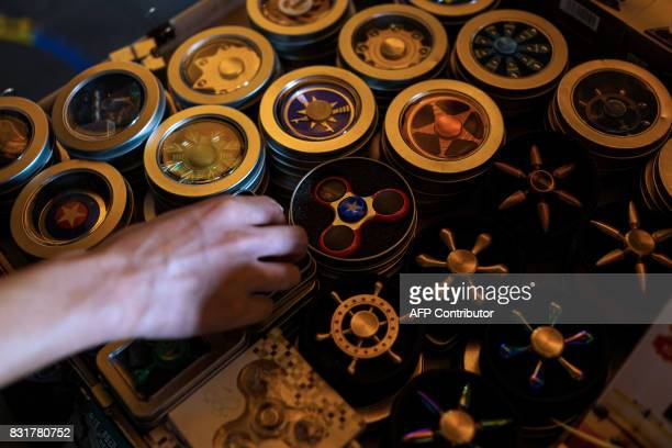 Fidget spinners of American superhero Captain America are displayed for sale in a shop in Shanghai on August 15 2017 Trade tensions between the...