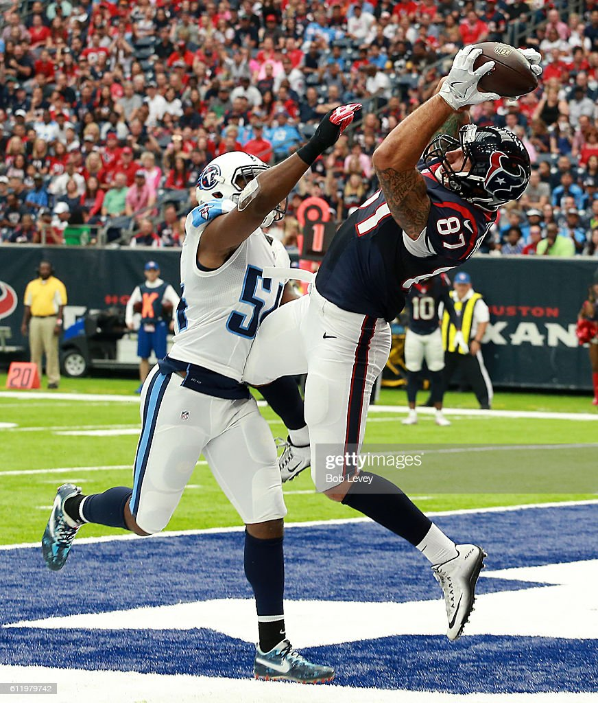 C.J. Fiedorowicz #87 of the Houston Texans catches a pass for a touchdown with Avery Williamson #54 of the Tennessee Titansof the Tennessee Titans defending during the NFL game at NRG Stadium on October 2, 2016 in Houston, Texas.