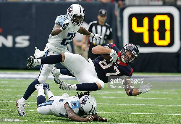 J Fiedorowicz of the Houston Texans is gang tackled by Tennessee Titans defense in the first half at NRG Stadium on October 2 2016 in Houston Texas
