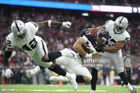 J Fiedorowicz of the Houston Texans makes a catch against Karl Joseph and Malcolm Smith of the Oakland Raiders during the AFC Wild Card game at NRG...