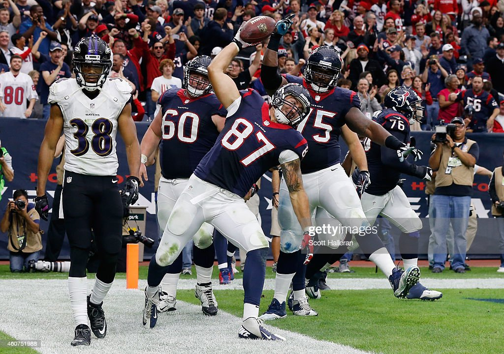 C.J. Fiedorowicz #87 of the Houston Texans spikes the ball in front of Rashaan Melvin #38 of the Baltimore Ravens after scoring a second-half touchdown during their game at NRG Stadium on December 21, 2014 in Houston, Texas.
