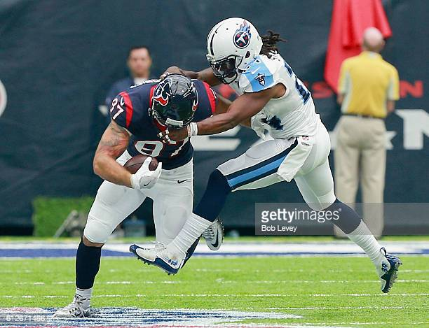 J Fiedorowicz of the Houston Texans'n is tackled by Daimion Stafford of the Tennessee Titans at NRG Stadium on October 2 2016 in Houston Texas