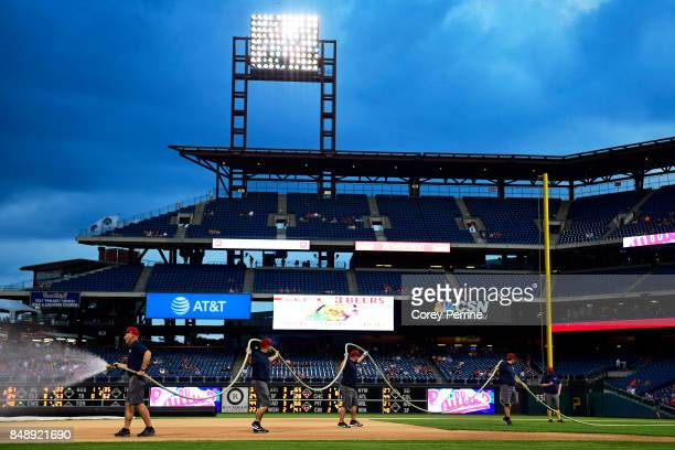 Field crew members prep the field before the game between the Philadelphia Phillies and the Oakland Athletics at Citizens Bank Park on September 16...