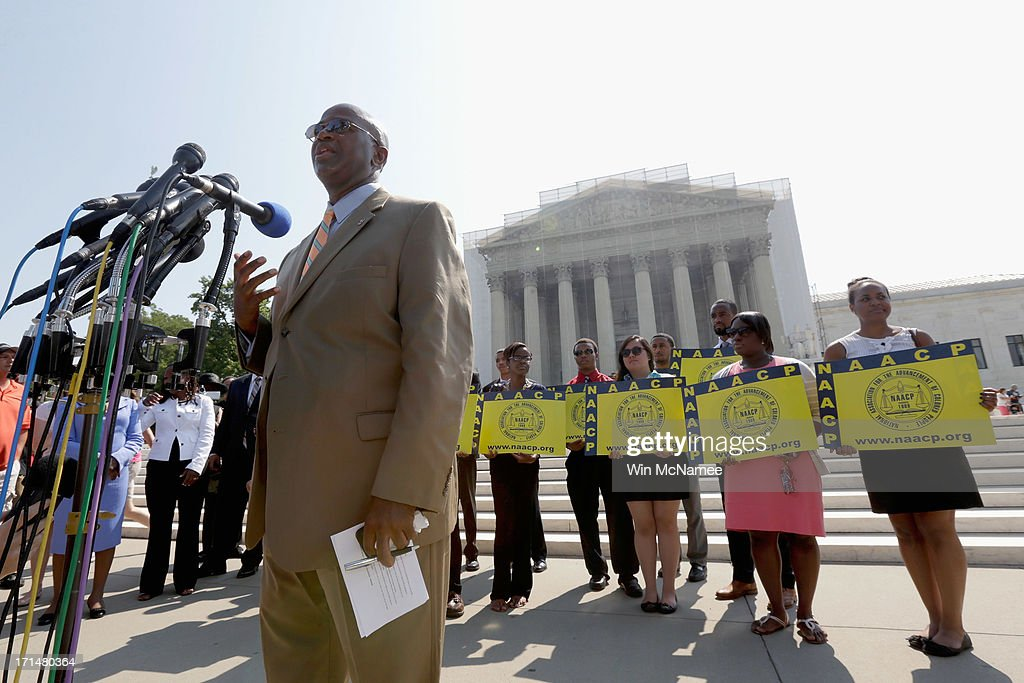 Field Director Charles White of the National Association for the Advancement of Colored People (NAACP) speaks at a podium outside the U.S. Supreme Court building on June 25, 2013 in Washington, DC. The court ruled that Section 4 of the Voting Rights Act, which aimed at protecting minority voters, is unconstitutional. The high court convened again today to rule on some high profile decisions including two on gay marriage and one on voting rights.