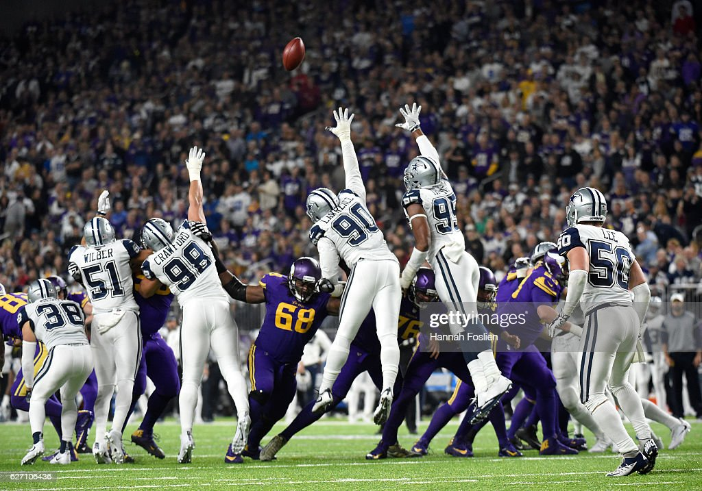 A field goal kick by Kai Forbath #2 of the Minnesota Vikings sails over the Dallas Cowboys defense in the fourth quarter of the game on December 1, 2016 at US Bank Stadium in Minneapolis, Minnesota.