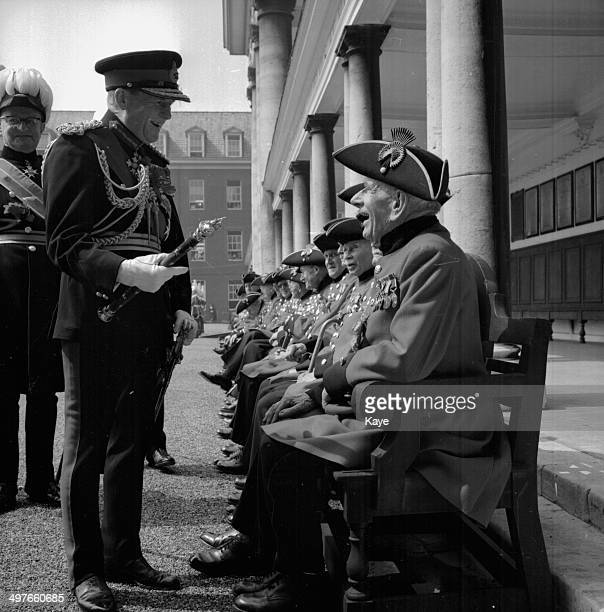 Field Marshal Lord Harding reviews a group of Chelsea Pensioners on Founders Day Royal Hospital Chelsea May 30th 1964