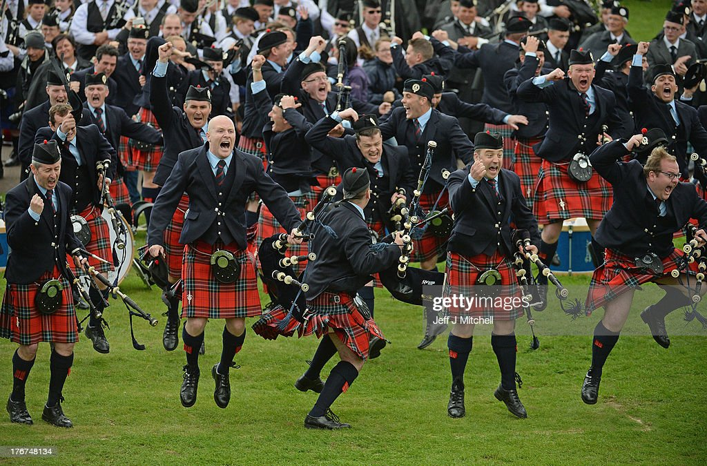 Field Marshall Montgomery celebrate winning the 2013 World Pipe Band Championships for the third year in a row at Glasgow Green on August 18,2013 in Glasgow,Scotland. The World Pipe Band Championships has returned to Glasgow this weekend, with 225 pipe bands competing for the title.