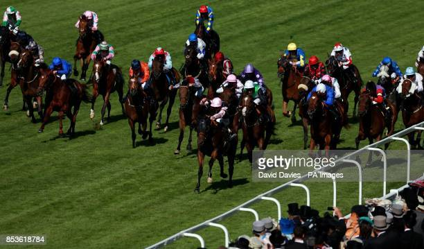 Field of Dream ridden by Adam Kirby on their way to victory in the Royal Hunt Cup during Day Two of the 2014 Royal Ascot Meeting at Ascot Racecourse...