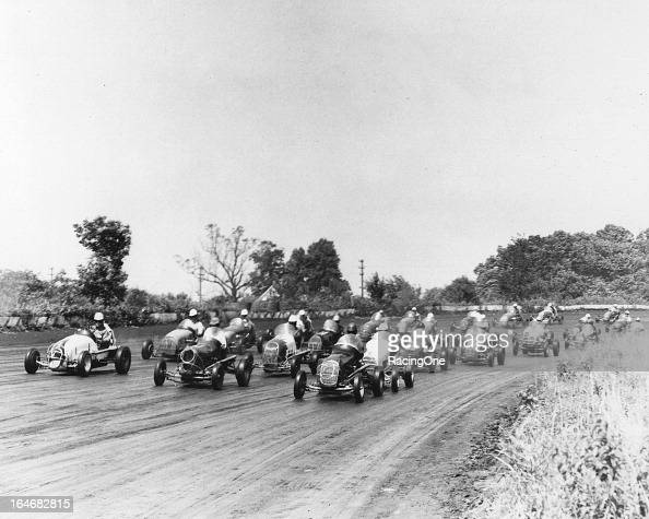 A field of Midget racecars gets set for the start of a race on the onemile Langhorne Speedway