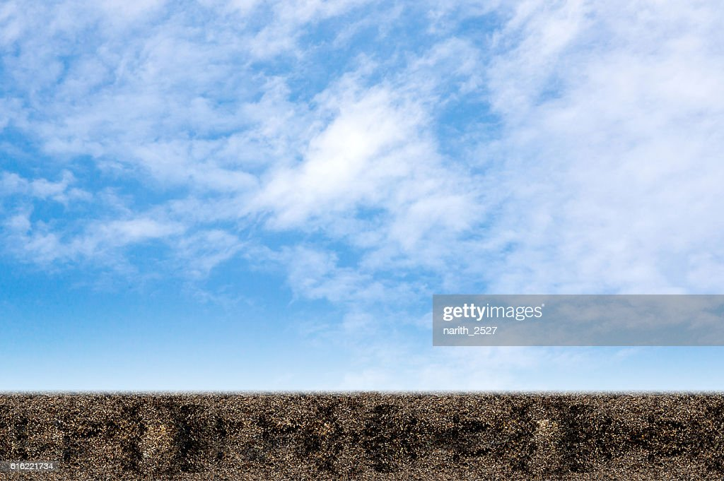 field of soil on a background of blue sky. : Stock-Foto