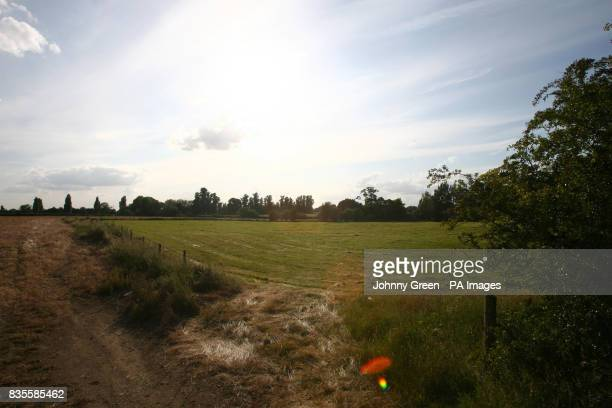 A field patrolled by Police in Sutton Courtenay near Abingdon in Oxfordshire where two people were today killed in a midair crash today when their...