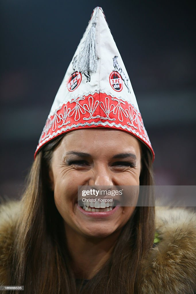 Field reporter Laura Wontorra of sport 1 television channel poses with a carnival cap prior to the Second Bundesliga match between 1. FC Koeln and 1. FC Union Berlin at RheinEnergieStadion on November 4, 2013 in Cologne, Germany.