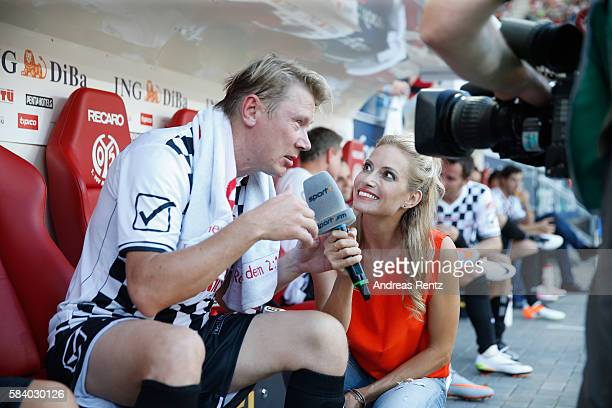 Field reporter Sarah Winkhaus during an interview with mika Hakkinen during the 'Champions for charity' football match between Nowitzki All Stars and...