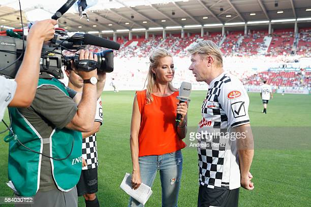 Field reporter Sarah Winkhaus in interview with Mika Hakkinen during the 'Champions for charity' football match between Nowitzki All Stars and...