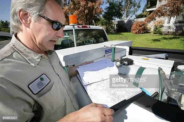 Field Technician Jeff Gay with the SacramentoYolo Mosquito and Vector Control District looks over a map listing unmaintained swimming pools in Folsom...