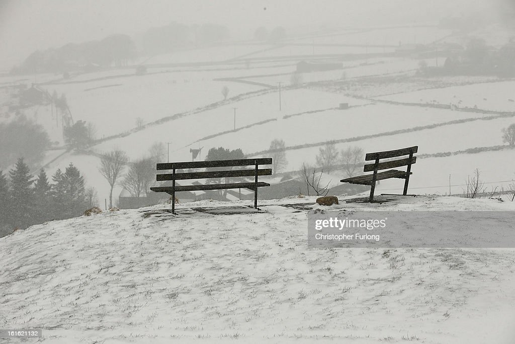 Fields are covered in snow near the Pennine town of Heptonstall on February 13, 2013 in Heptonstall, England. Britain is again feeling the effects of snow with some parts of the country being issued with a yellow weather warning.