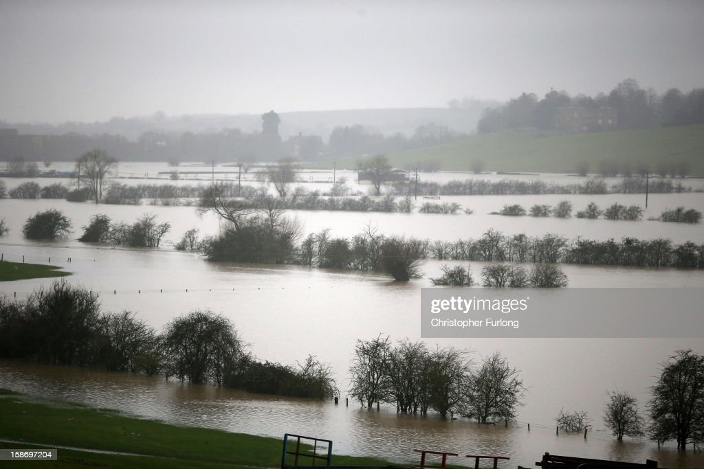 Fields are flooded near Tewkesbury at the confluence of the River Severn and the River Avon suffers flooding on December 24, 2012 in Tewkesbury, England. Forecasters have predicted more rain to sweep across the country causing flash flooding over the coming days. The South West of England has been badly affected causing major disruption to the rail network delaying journeys for people making their way home for Christmas.
