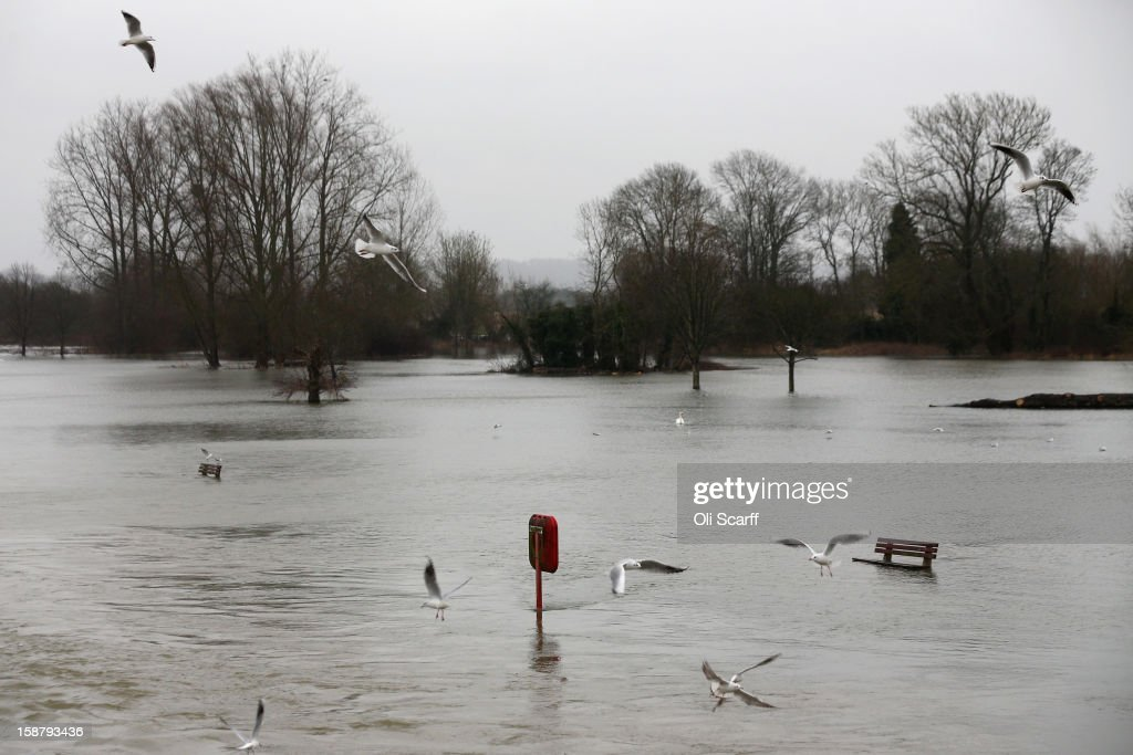 Fields are submerged by flood waters from the River Thames on December 29, 2012 in Pangbourne, England. The Environment Agency has issued widespread flood warnings across the UK whilst the Met Office has predicted further rain forecast for the remainder of 2012, which is likely to be recorded as the wettest year since records began in 1910.