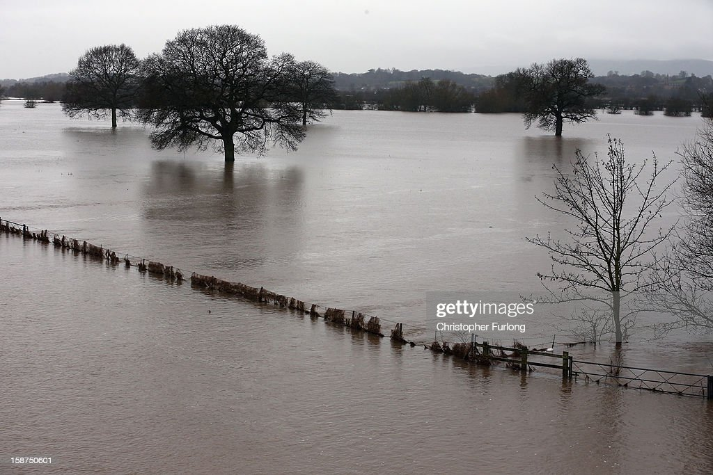 Fields covered with flood water as the River Severn breaks it's banks on December 27, 2012 in Worcester, England. 2012 could be the UK's wettest year on record according to forecasters and there are currently 88 flood warnings and 207 flood alerts in England and Wales. The Environment Agency in Hereford and Worcestershire are expecting further heavy rain, delaying a clean up until after the weekend.