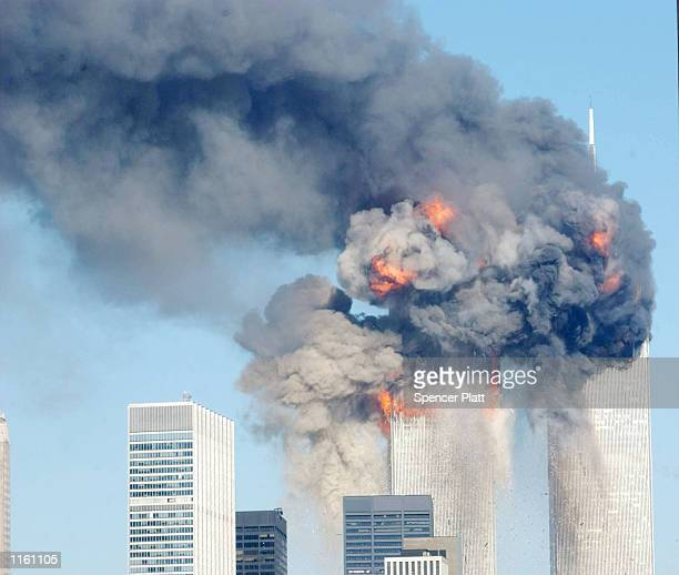 A fiery blasts rocks the World Trade Center after being hit by two planes September 11 2001 in New York City