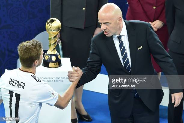 Fifa President Gianni Infantino congratulates Germany's forward Timo Werner after they beat Chile 10 to win the trophy in the 2017 Confederations Cup...